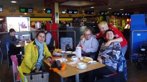 Group members enjoying lunch after bowling at Riverside Bowl, New Brighton.